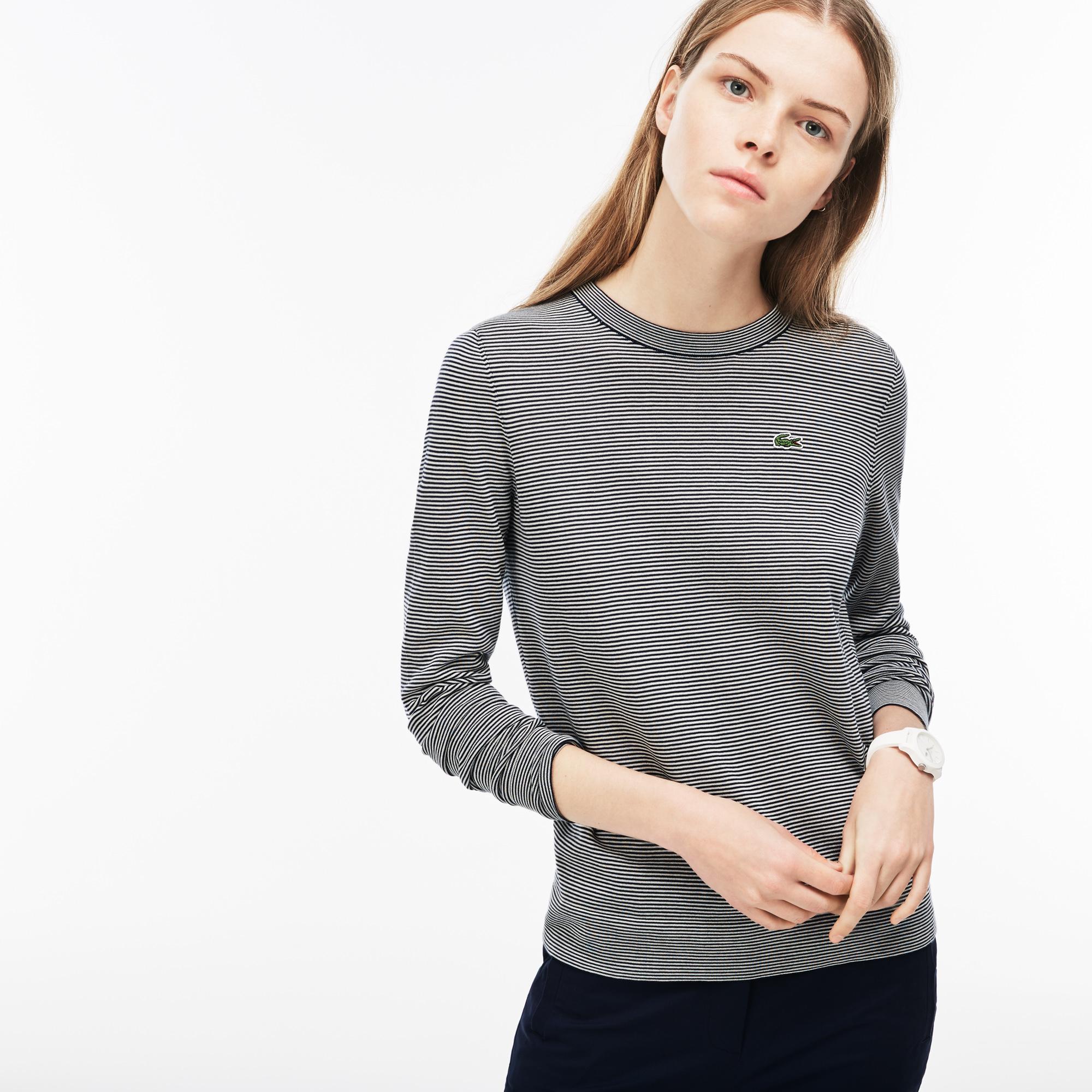Свитер LacosteСвитеры<br>Детали: женский свитер с принтом  \ Материал: 100% хлопок 98% хлопок 1% эластан 1% полиамид \ Страна производства: Китай