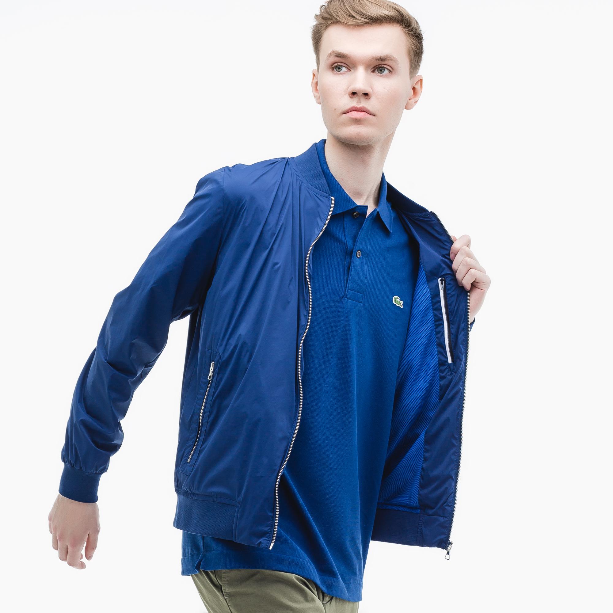 Фото 3 - Куртку Lacoste синего цвета