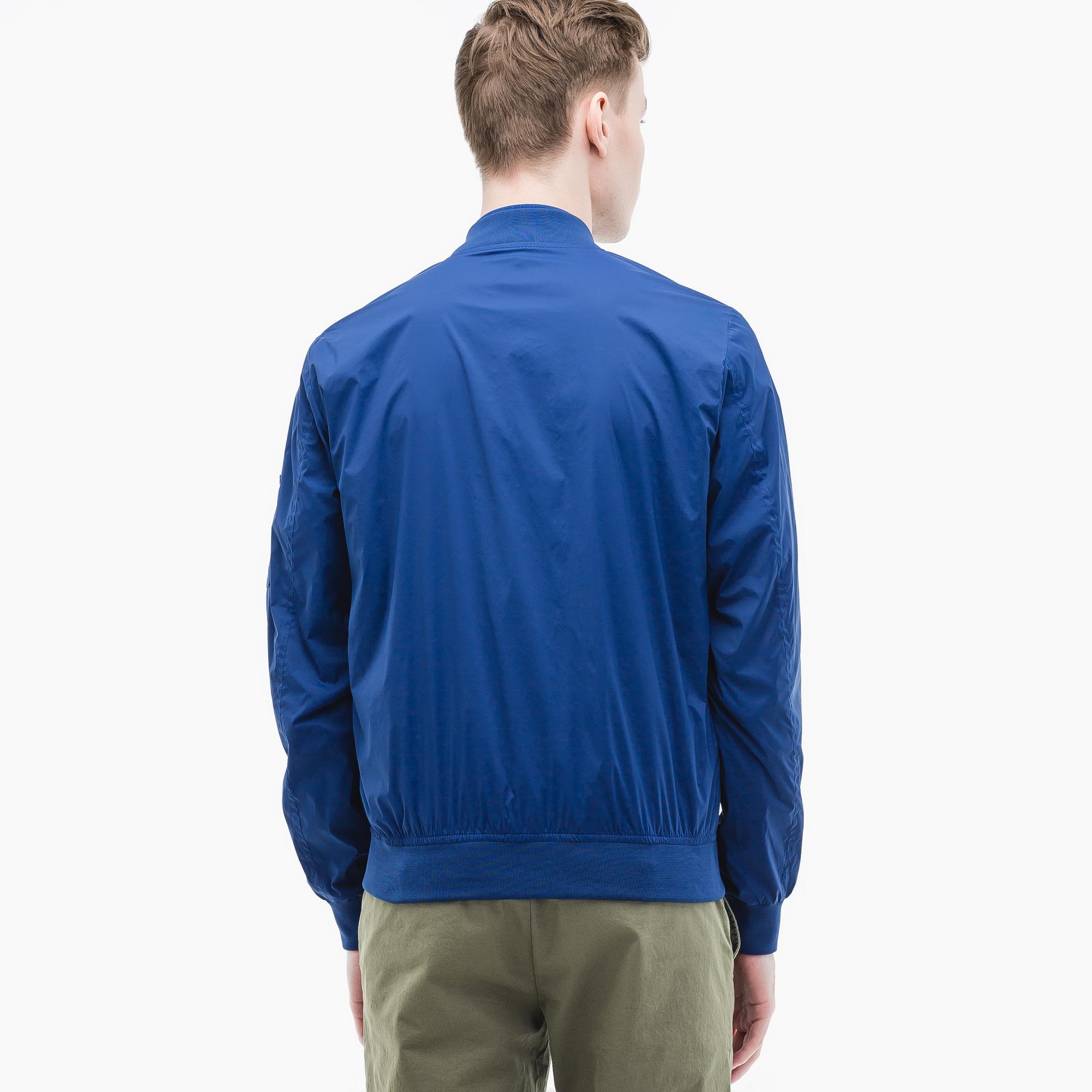Фото 4 - Куртку Lacoste синего цвета