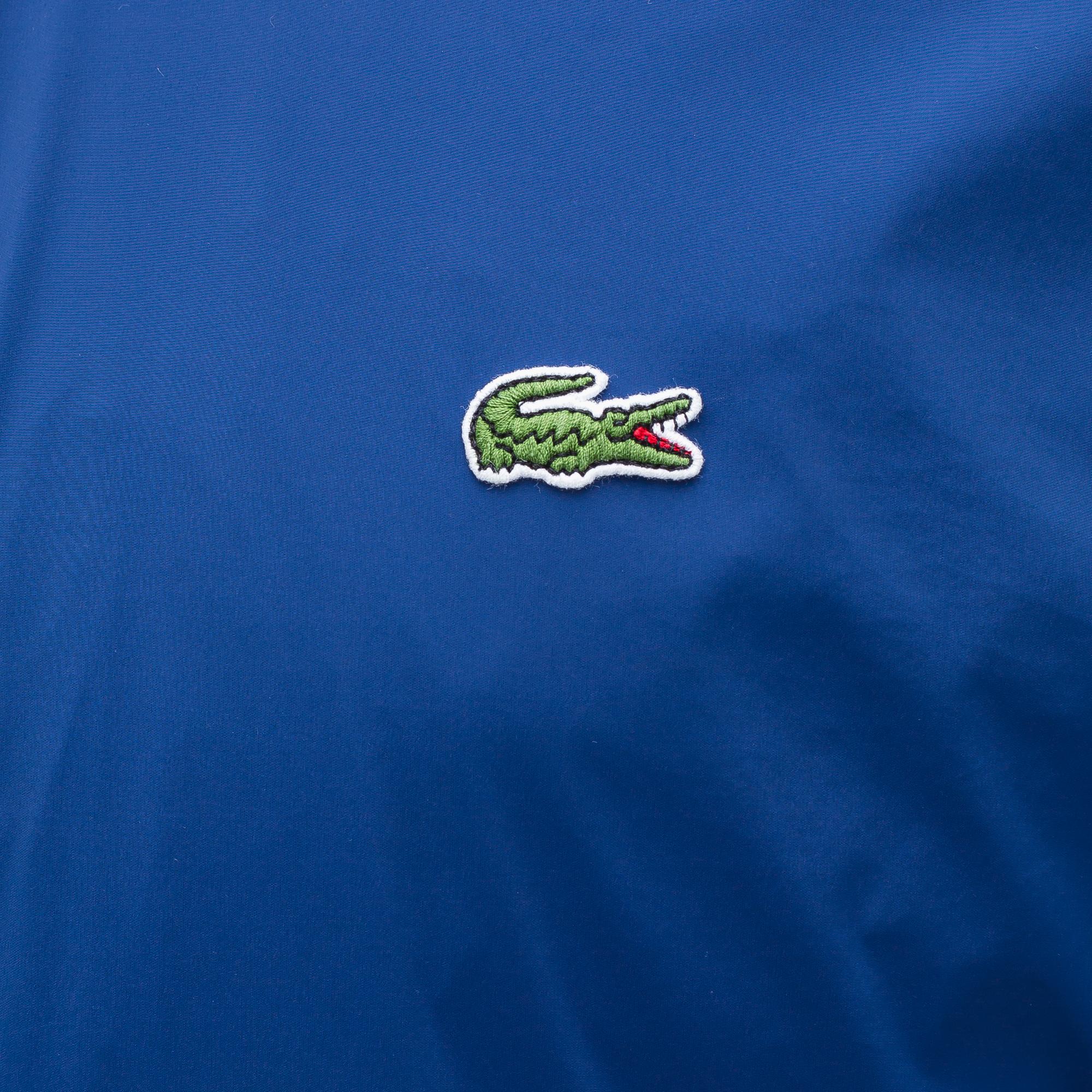 Фото 5 - Куртку Lacoste синего цвета