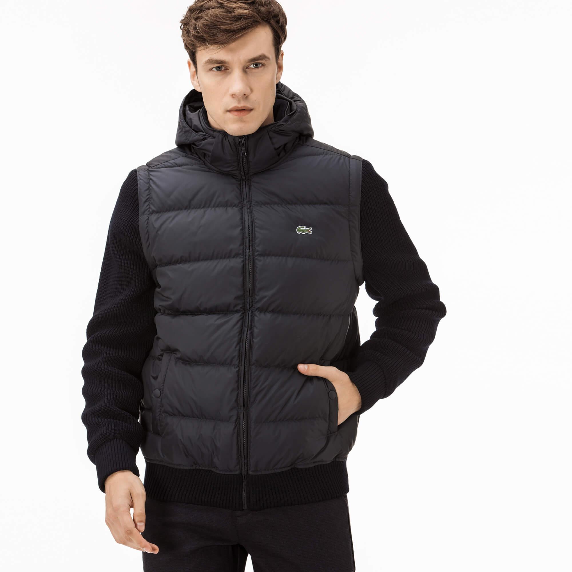 Куртка LacosteВерхняя одежда<br>Детали: на молнии;\Капюшон и отстегивающиеся рукава;\Эластичный ворот и нижний край;\Классический логотип Lacoste\Материал: 100% полиэстер 50% шерсть 50% акрил