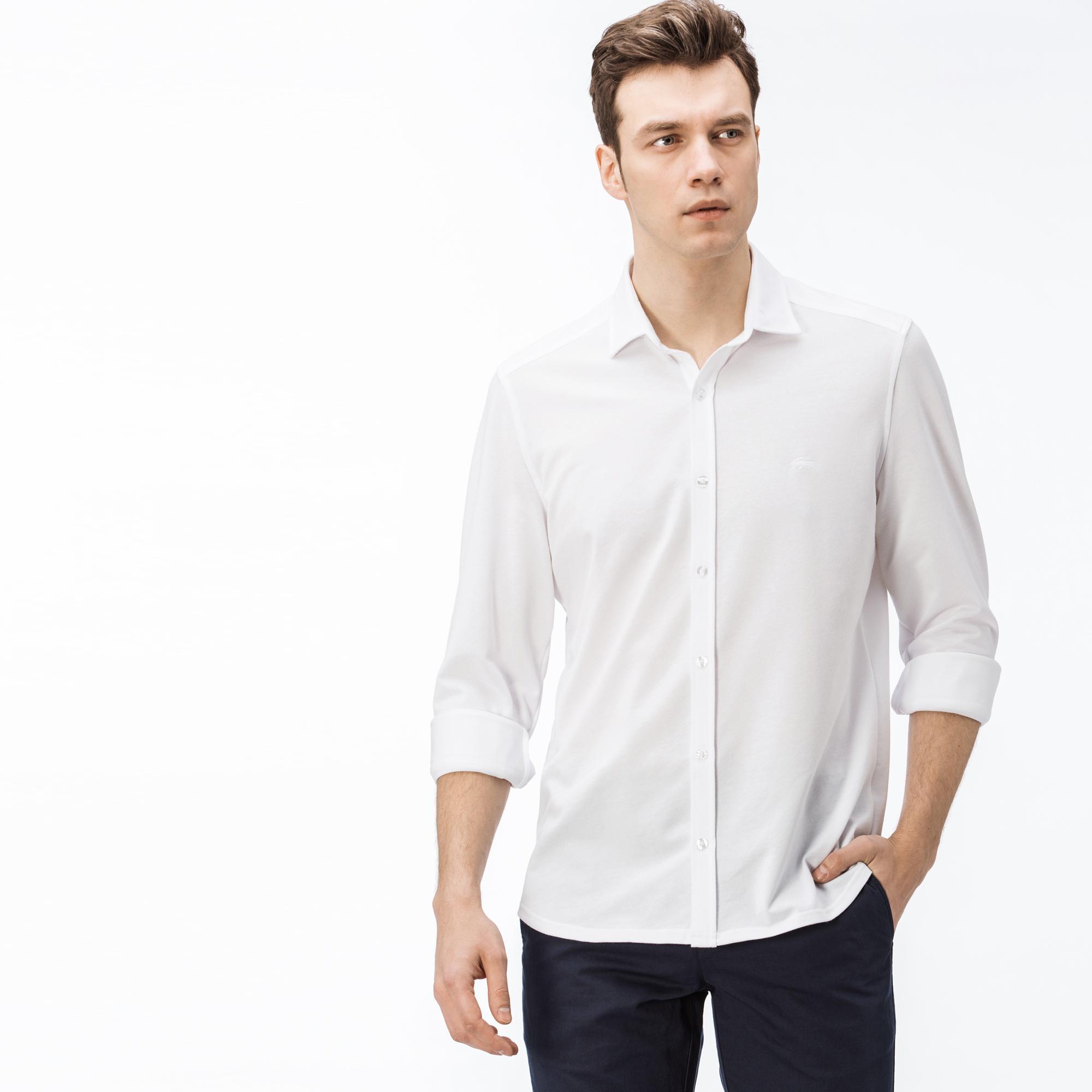Рубашка LacosteРубашки<br>Детали: отложной воротник;\Вышитый логотип Lacoste в тон изделия\Материал: 55% хлопок 45% полиэстер
