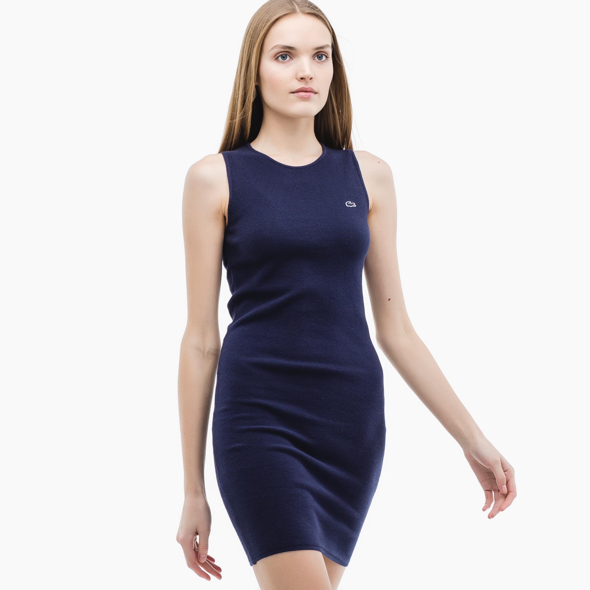 Фото 2 - Женское платье Lacoste синего цвета