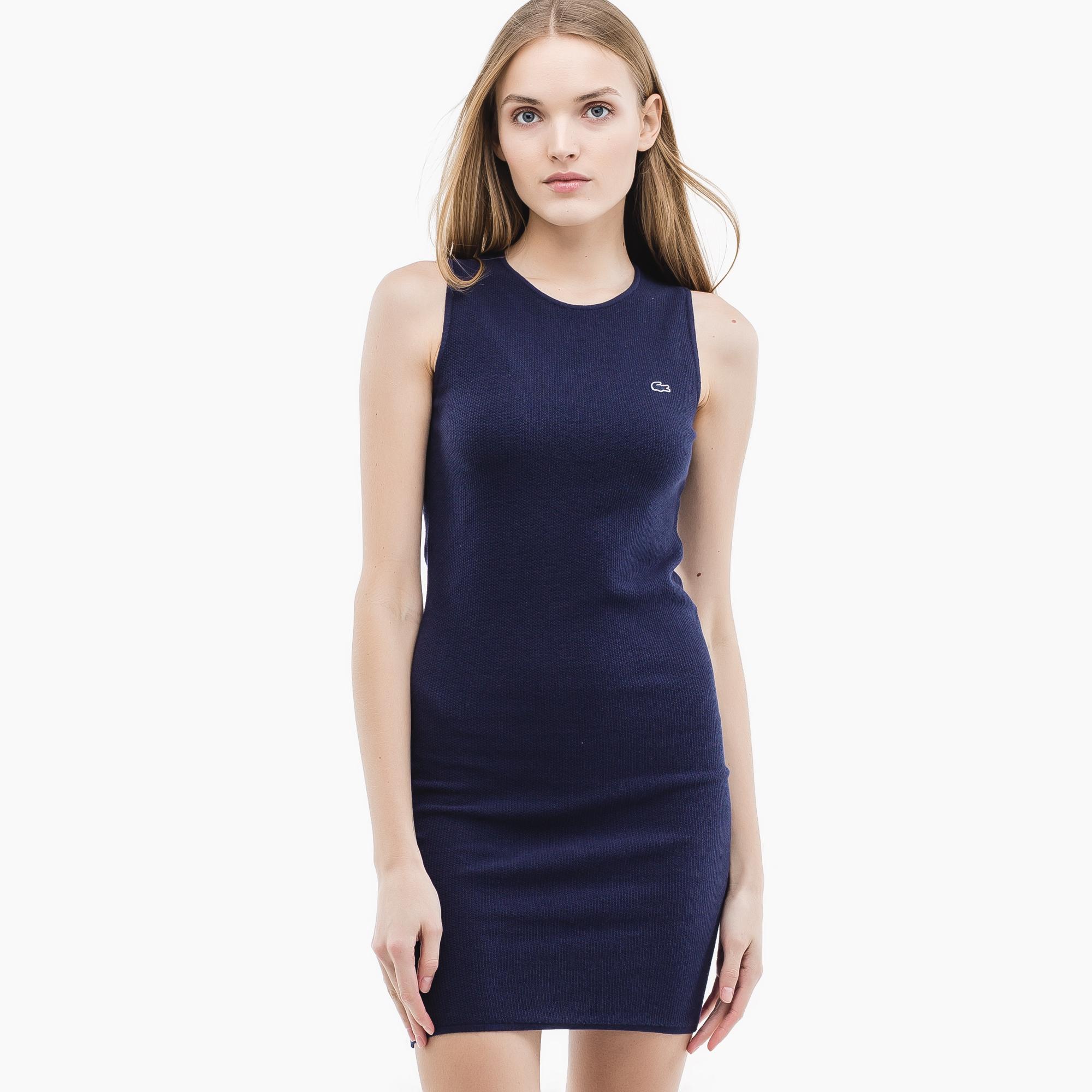 Фото 3 - Женское платье Lacoste синего цвета