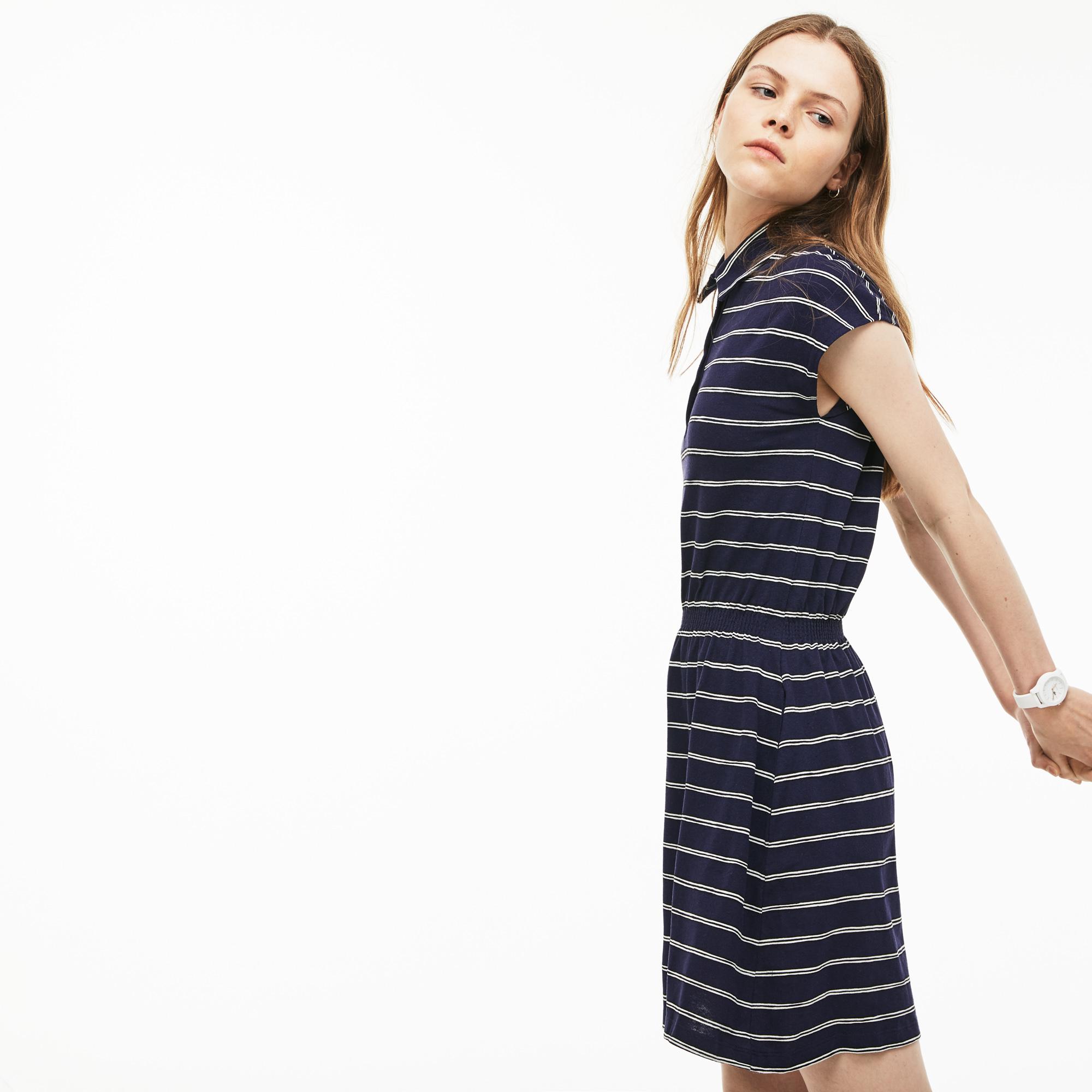 Фото 3 - Женское платье Lacoste темно-синего цвета