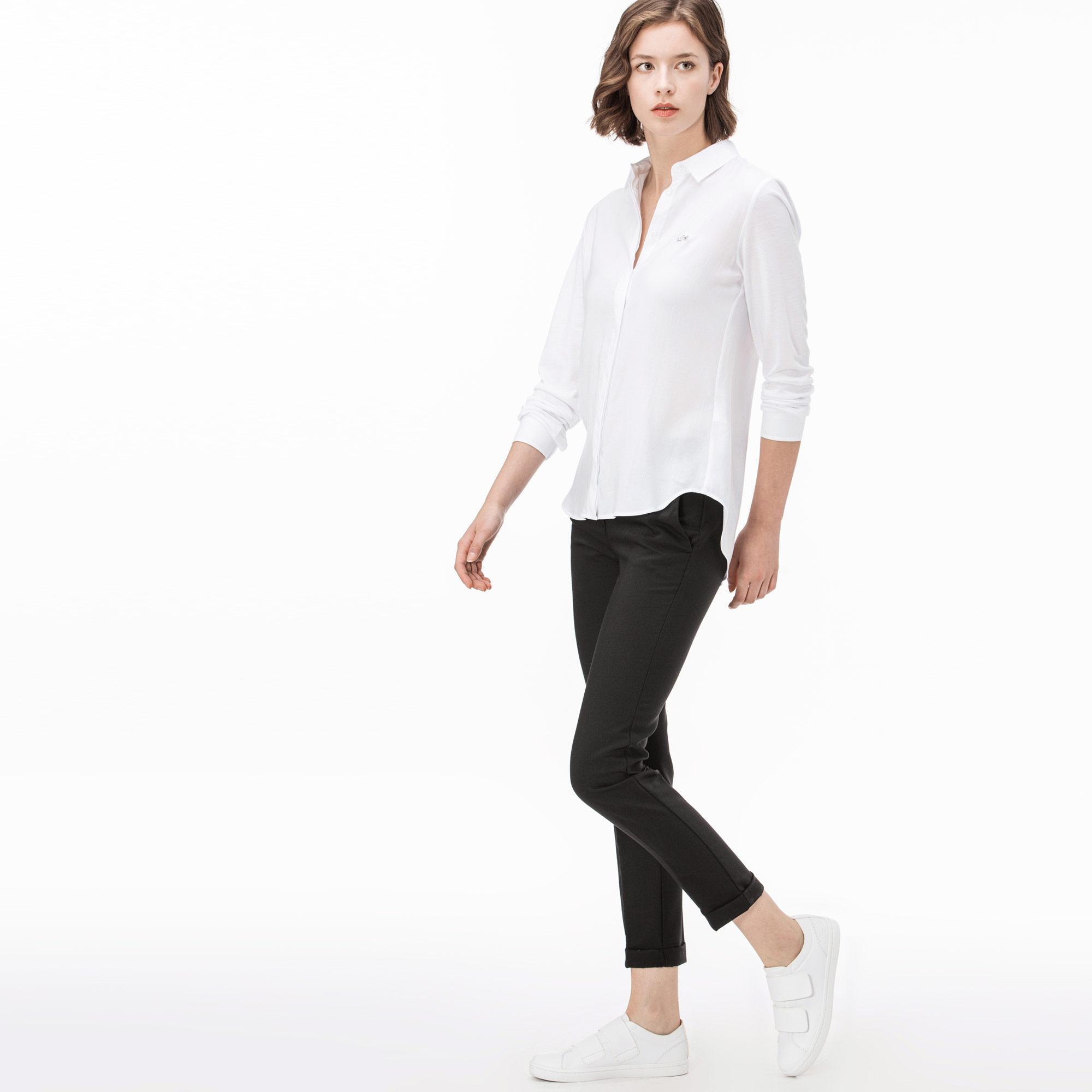 Фото 3 - Женские брюки Lacoste зеленого цвета