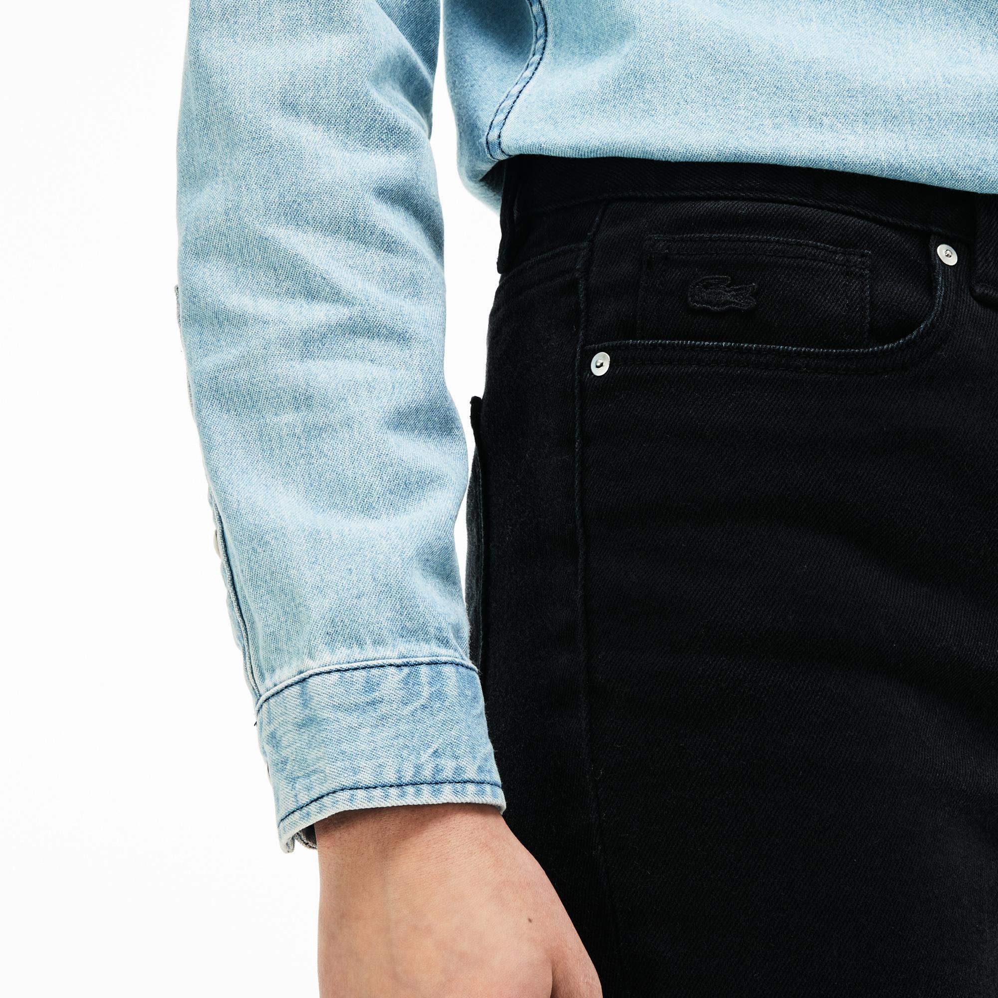 Фото 4 - Женские брюки Lacoste черного цвета