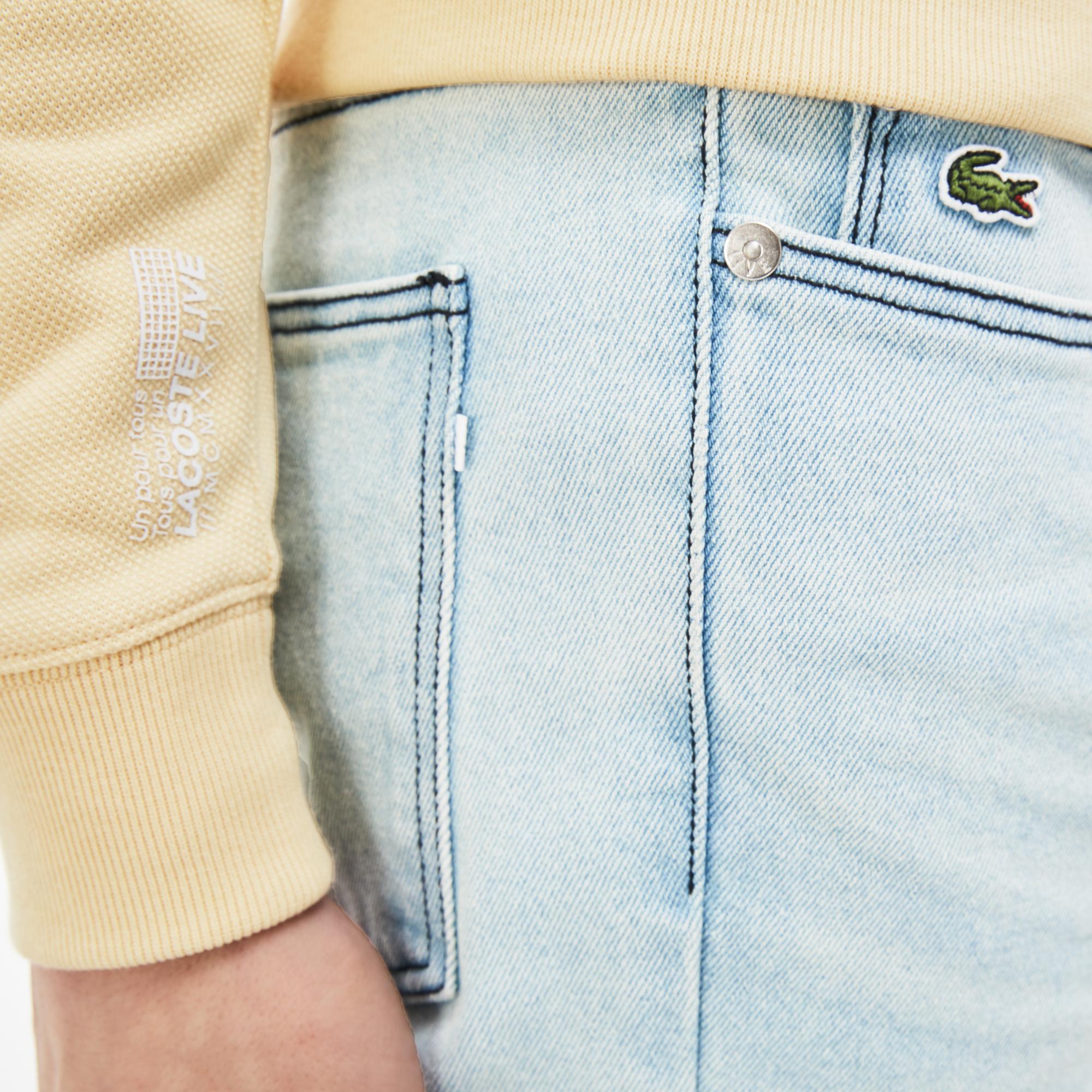 Фото 3 - Джинсы Lacoste Slim fit голубого цвета