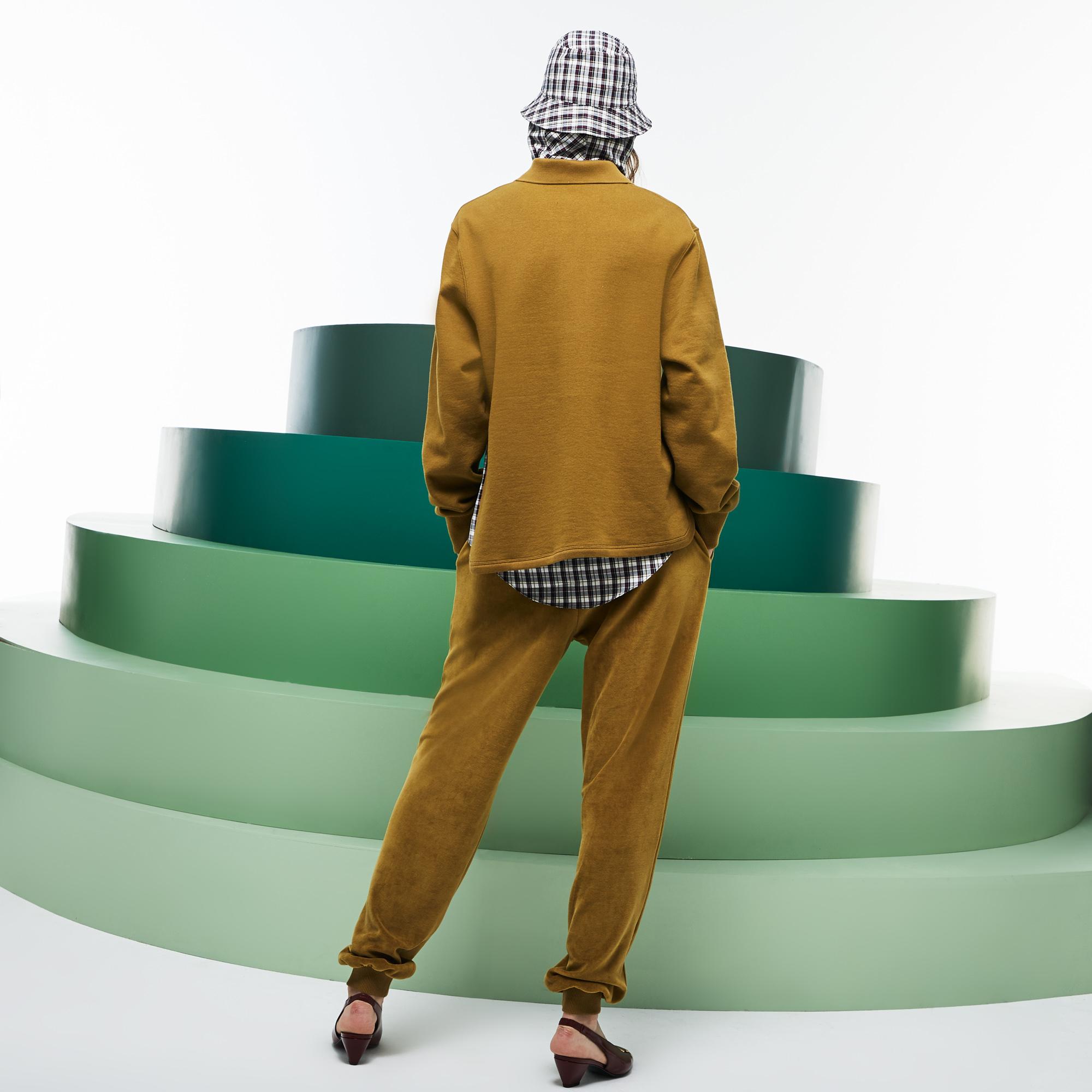 Фото 3 - Спортивные штаны Lacoste коричневого цвета