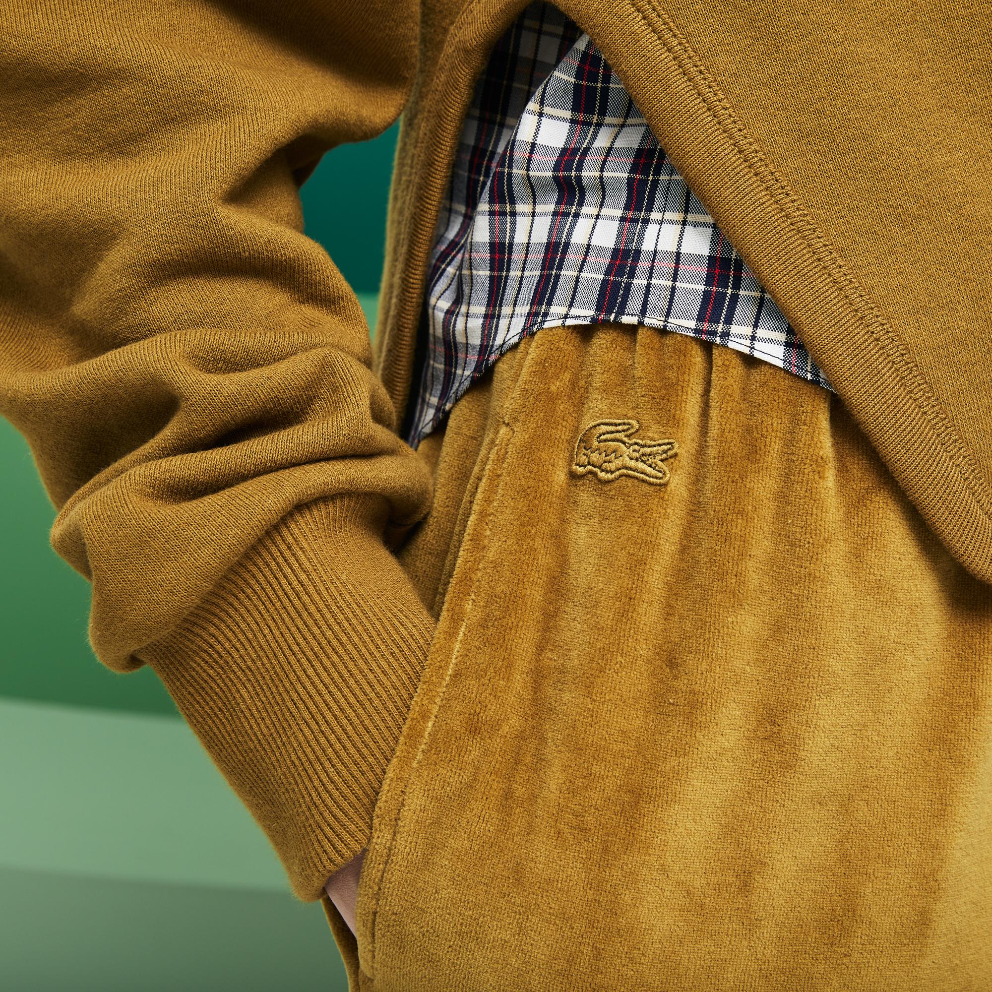 Фото 4 - Спортивные штаны Lacoste коричневого цвета