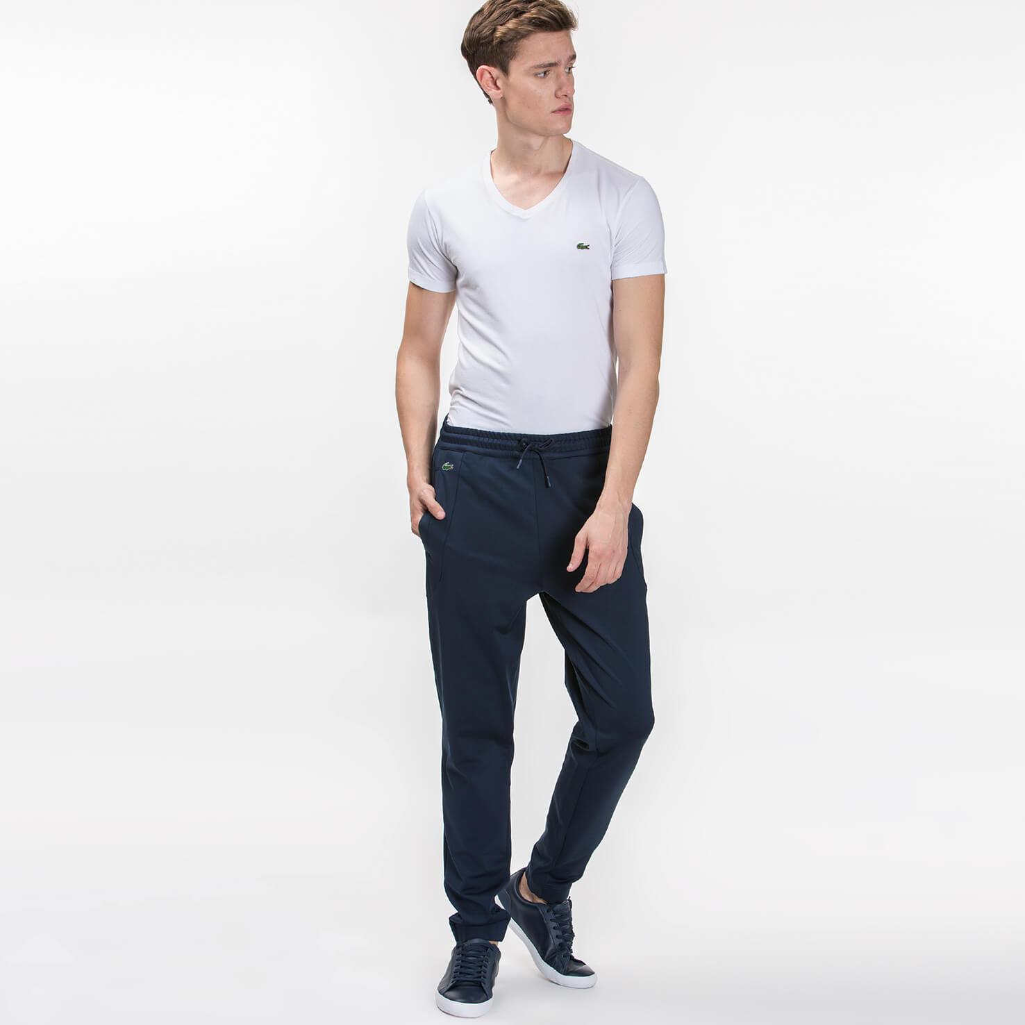 Спортивные штаны LacosteСпортивная одежда<br>Детали: мужские спортивные штаны  \ Материал: 92% полиэстер 8% эластан \ Страна производства: Турция
