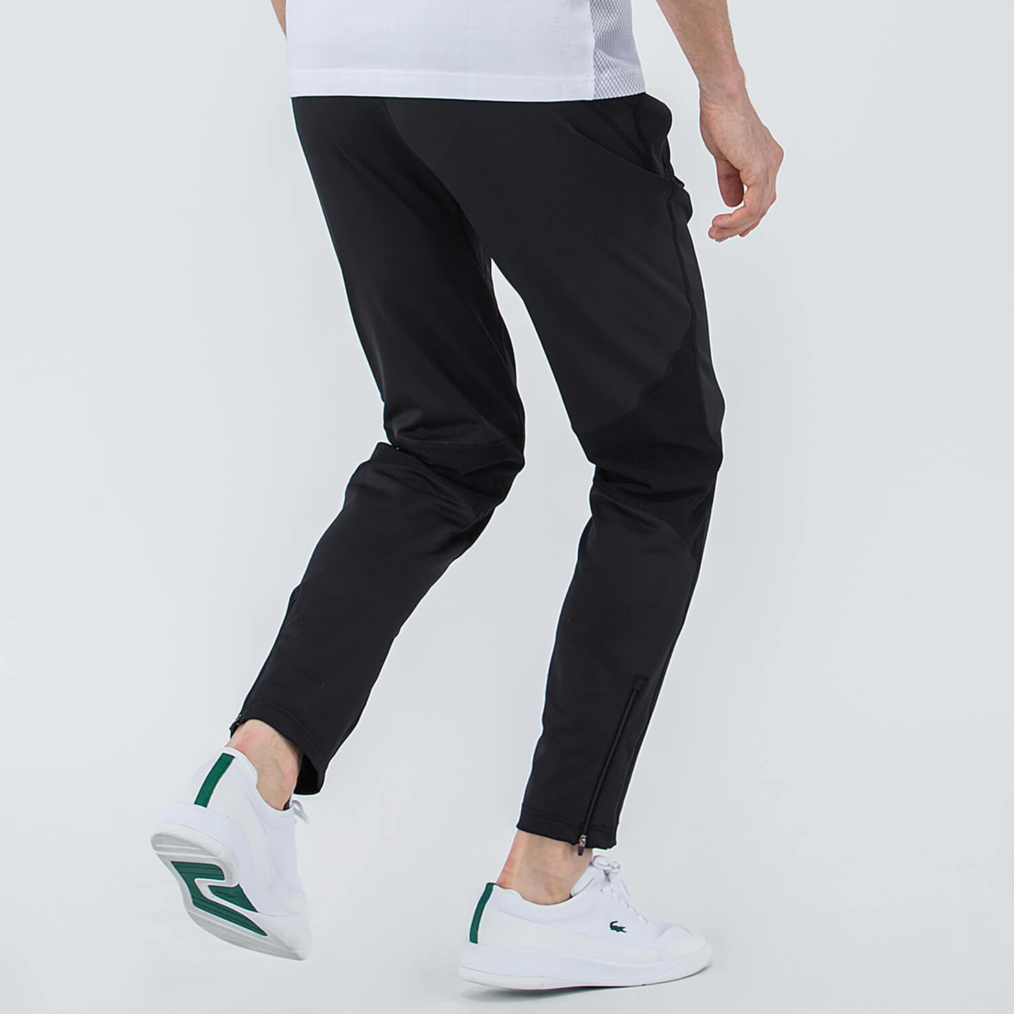 Фото 2 - Спортивные штаны Lacoste черного цвета