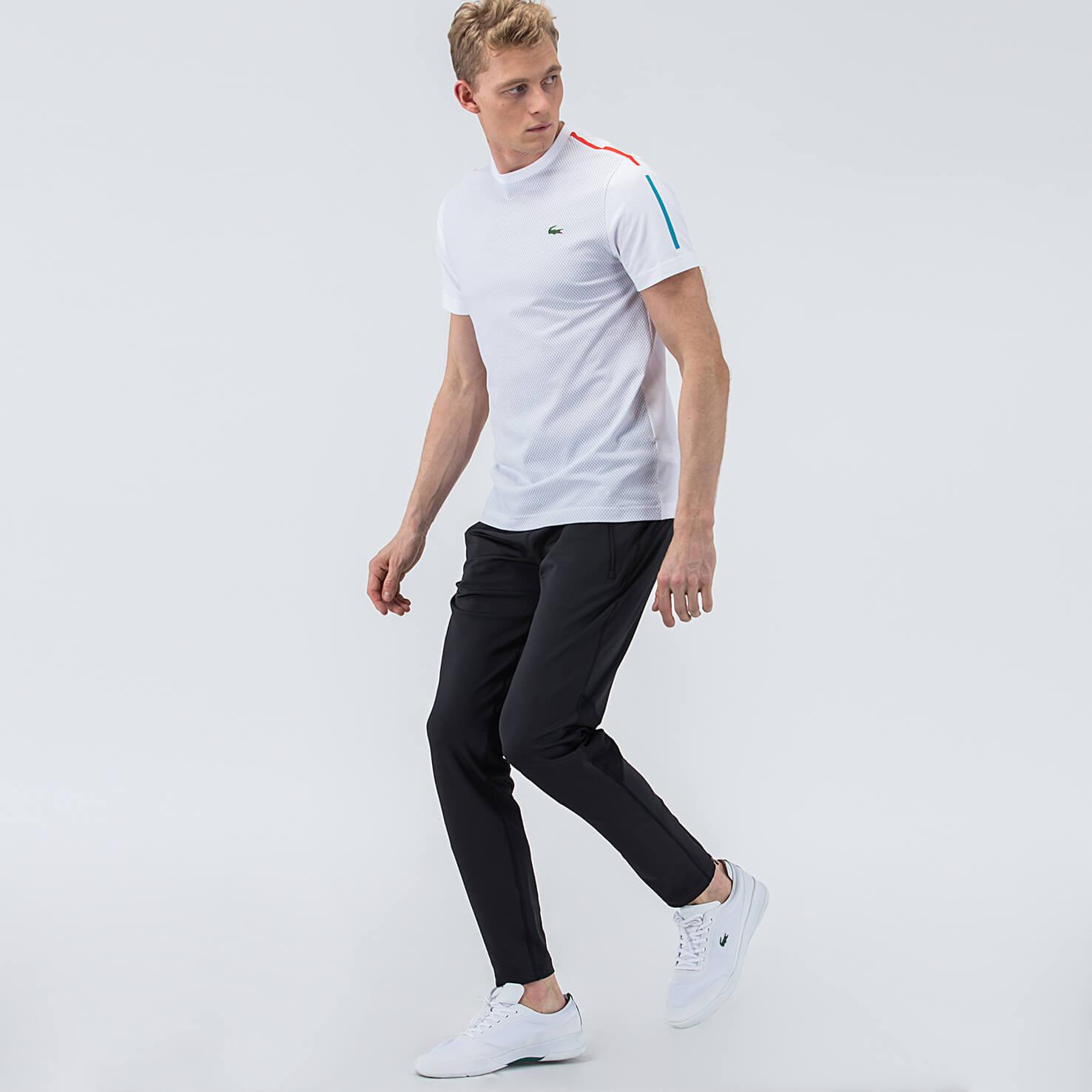 Фото 3 - Спортивные штаны Lacoste черного цвета