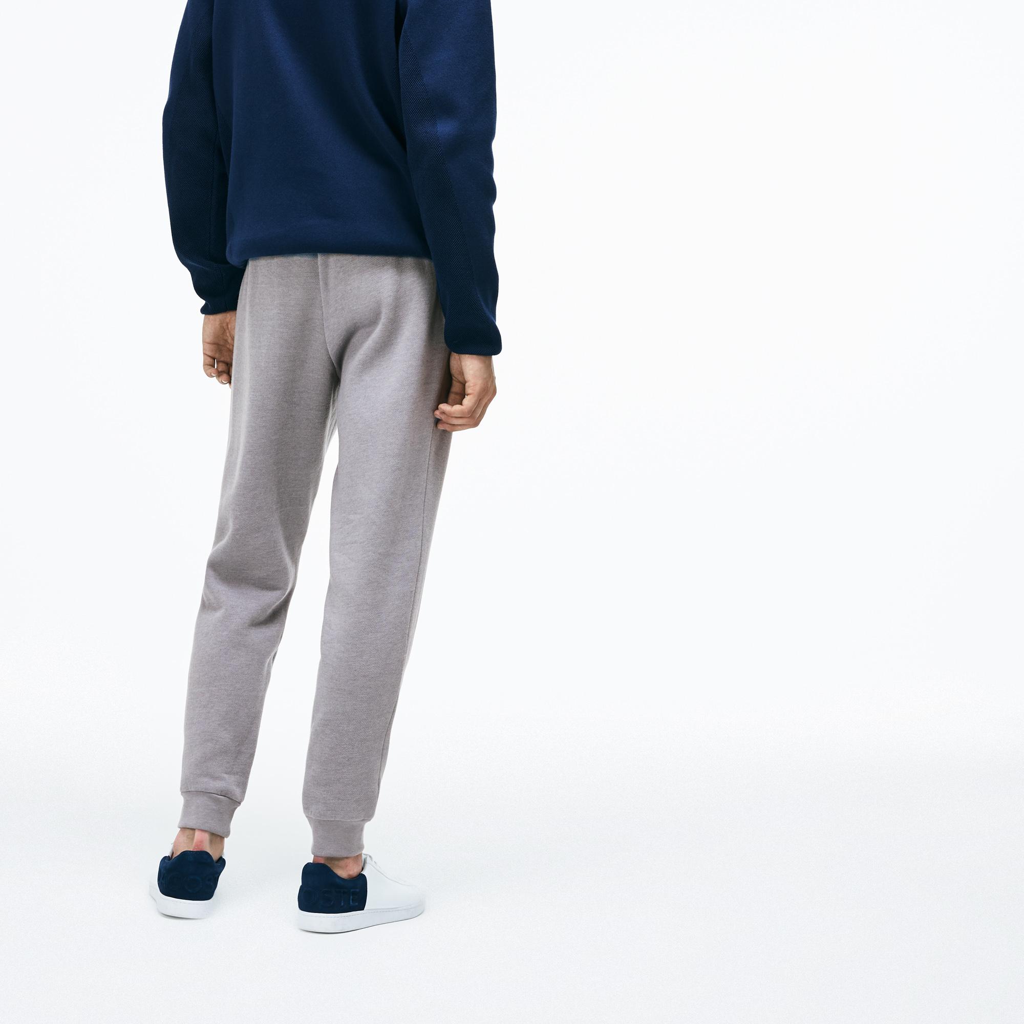 Фото 2 - Спортивные штаны Lacoste серого цвета