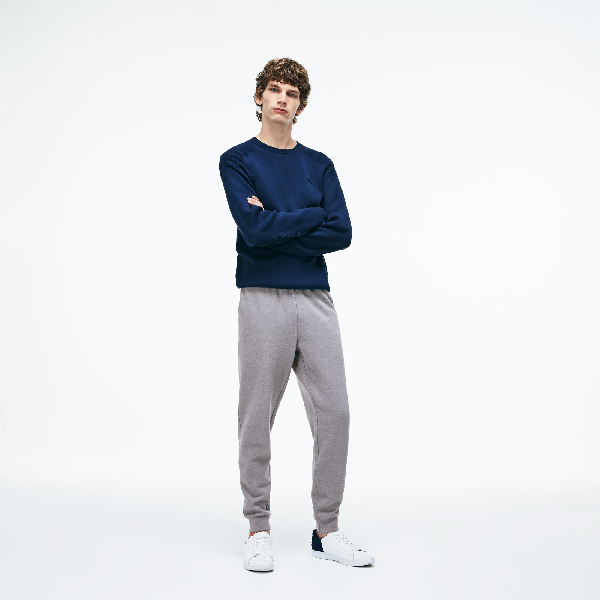 Фото 3 - Спортивные штаны Lacoste серого цвета