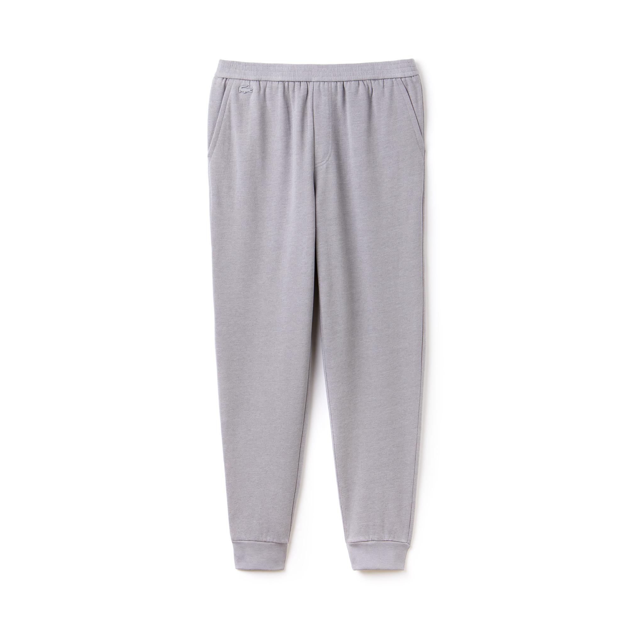 Фото 5 - Спортивные штаны Lacoste серого цвета